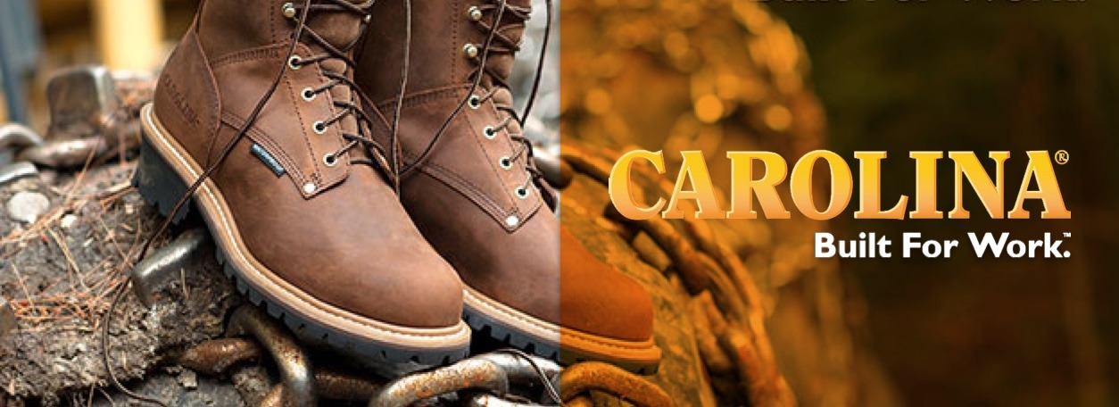 Carolina Boots logo with boots on fallen tree in background